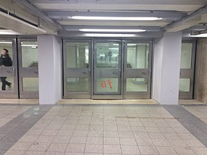 "Chambers Street–World Trade Center/Park Place (New York City Subway) - Doorway to PATH station, including preserved door from 9/11 with the words ""MATF 1 / 9 13"" spray-painted on it"