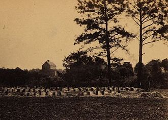 Hampton Park (Charleston) - Union soldiers were buried behind the old racetrack's stands near the present intersection of Tenth Ave. and Mary Murray Drive.