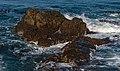 Waves crashing into rocks off the shore of Robben Island.jpg