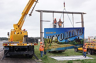 Wyoming Department of Transportation - Wyoming Department of Transportation employees put up a new welcome sign in the Spring of 2017.
