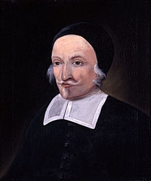 A painting of a man with a white moustache and small beard.  He is wearing a skull cap and the bib of a colonial-era minister.