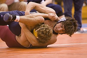 Two high school students wrestling (collegiate...
