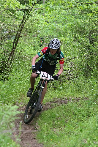Single track (mountain biking) - A cross-country rider on singletrack during a race.