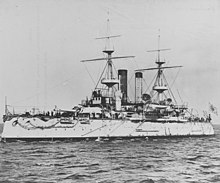 Black and white image of a white-painted warship