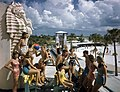 Young people gathered near sea horse sculptures at the municipal casino in Lido Beach, Florida.jpg