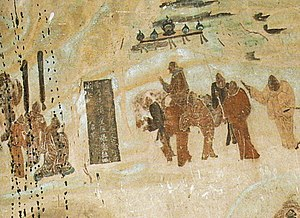 Yuezhi - A later mural (c. 618–712 CE) from the Mogao Caves, depicting the Chinese mission of Zhang Qian to the Yuezhi in 126 BC.