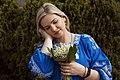 День Вишиванки. Молода україночка у вишитій синій сукні серед квітів 31.jpg