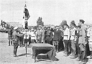 51st Rifle Division (Soviet Union) - Mikhail Frunze presents divisional commander Pavel Dybenko with an honorary revolutionary red banner in Crimea in 1921