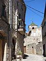 049 Carrer de la Font (Vallfogona de Riucorb), al fons campanar de Santa Maria.jpg