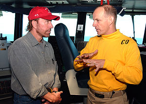 Chuck Norris - Norris during a meeting with Commanding Officer Captain J.R Haley, in June 2005