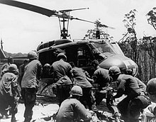 101st Airborne Division Soldiers are loaded on to a UH-1 during Operation Apache Snow , May 1969.jpg