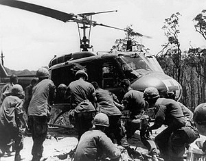 Battle of Hamburger Hill - Wounded Soldiers are loaded on to a UH1 helicopter during Operation Apache Snow, May 1969.