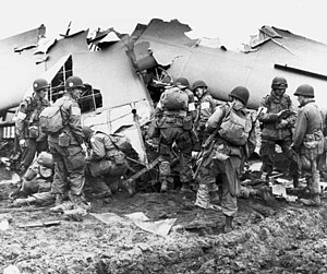 History of the 101st Airborne Division - Men of the 101st Airborne Division inspect a broken glider, September 1944.