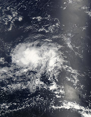 Satellite image of elliptical cloud pattern with no clear center