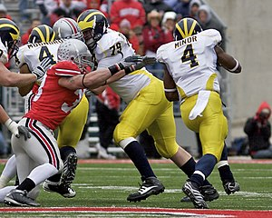 James Laurinaitis - Laurinaitis (red) chases Brandon Minor during the 2008 Michigan–Ohio State rivalry game.
