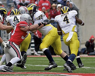Michigan–Ohio State football rivalry - James Laurinaitis attempts to tackle Brandon Minor.