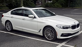 2018 BMW 540i in white, front right.jpg