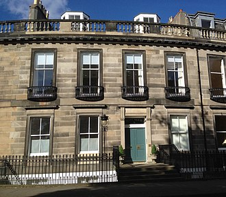 Carlton Terrace, Edinburgh - 9 Carlton Terrace, a four-bayed townhouse in the centre of the bend, with balustraded parapet and balconettes on the first floor