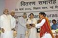 A.P.J. Abdul Kalam, giving away the Nirmal Gram Puraskar to the Panchayati Raj Institution of Assam for achieving full sanitation coverage at a function.jpg