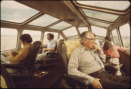 Southwest Limited dome car, 1974. Photo by Charles O'Rear. ARIZONA AND NEW MEXICO SCENERY ATTRACT PASSENGERS TO THE DOME CAR OF THE SOUTHWEST LIMITED, AN OVERNIGHT TRAIN FROM... - NARA - 555976.jpg