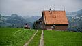 AR Sturzenegg Bauernhaus and a farmer at work.jpg