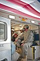 A 10-year-old Afghan boy, second from left, waves goodbye as he is escorted from the Craig Joint Theater Hospital at Bagram Airfield, Afghanistan, Jan. 9, 2012 120109-A-ZU930-003.jpg