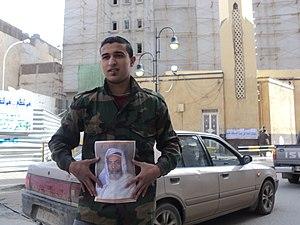 A Benghazi citizen holding King Idris's photo