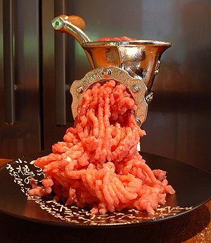 Meat grinder - A meat grinder in operation