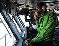 A Sailor works in primary flight control at sea. (8435774590).jpg