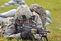 A U.S. Soldier assigned to Joint Multinational Training Command fires an M249 light machine gun during Expert Infantryman Badge (EIB) testing at the Grafenwoehr Training Area, Grafenwoehr, Germany, Aug. 27 120827-A-HE359-067.jpg