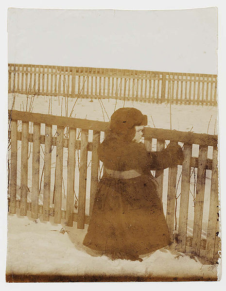 File:A child in a snow-covered garden, Hughesovka, about 1900.jpg