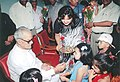 A little girl tying Rakhi to the Vice president Shri Bhairon Singh Shekhawat on the auspicious occasion of 'Raksha Bandhan' in New Delhi on August 30, 2004.jpg
