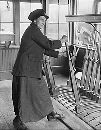 A woman railway worker operating the signals in a siding on the Great Central Railway in Birmingham during 1918. Q28148.jpg