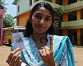A young voter showing mark of indelible ink after casting her vote, at a polling booth during the 3rd Phase of General Elections-2014, in Thiruvananthapuram, Kerala on April 10, 2014.jpg