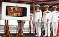 Admiral RK Dhowan, Chief of the Naval Staff unveiling the plaque of INS Sumitra along with Vice Admiral Satish Soni, FOC-in-C, East and Ships Commanding officer Commander MM Mokashi.jpg