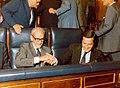 Adolfo Suárez y el vicepresidente 1º y Asuntos de Defensa se felicitan después de haber conseguido la confianza de la Cámara.jpg