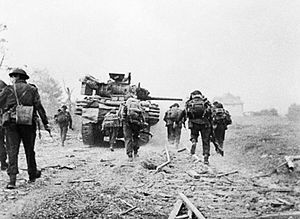 27th Armoured Brigade - Tanks of the 13th/18th Royal Hussars advance with No. 4 Commando on D-Day, 6 June 1944.