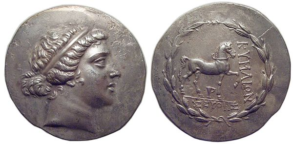 Aeolis, Kyme; Tetradrachm; Silver; circa 165-140 BC; Obverse: Head of the Amazon Kyme right, wearing taenia; Reverse: Horse walking right, skyphos (one handled cup) below, KUMAION left, SEUThES (magistrate) in exergue, all within laurel-wreath; 34.2mm, 16.409g; Reference: SNG Von Aulock 1640; Oakley obv. die 59; Sg4183 var Aeolis Kyme Tetradrachm.jpg