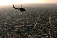 A helicopter flies over Mogadishu