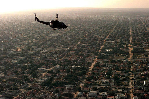 Aerial view of a US helicopter as it flies over a Mogadishu residential area