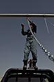 Afghan police build swing set for boys school 120517-M-DM345-011.jpg