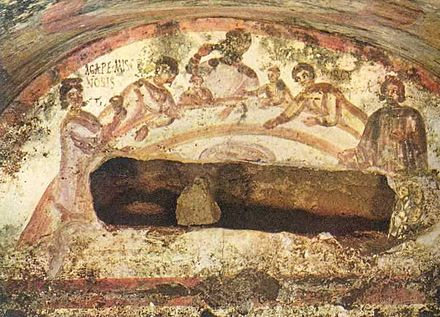 Fresco of a female figure holding a chalice at an early Christian Agape feast. Catacomb of Saints Marcellinus and Peter, Via Labicana, Rome. Agape feast 03.jpg