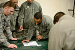 Airmen lay out map for fellow engineers 150212-F-MF529-048.jpg