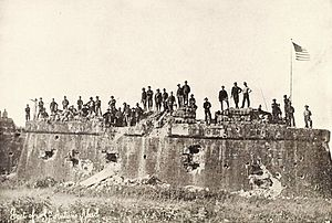 American troops raising the Flag at Fort San Antonio De Abad, Malate, Philippines (1899).jpg