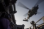 An MH-60R Sea Hawk Helicopter prepares to land on the flight deck of USS Dwight D. Eisenhower. (30488250443).jpg