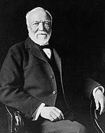 Andrew Carnegie, three-quarter length portrait, seated, facing slightly left, 1913 (cropped).jpg