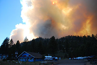 Angora Fire - The Angora Fire approaches a local business structure.