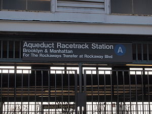 Aqueduct Racetrack (IND Rockaway Line) - This sign reflects the fact that there is only one platform at the station and it redirects passengers heading to the Rockaways to transfer at Rockaway Boulevard.