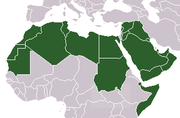 Map of the Arab League states in dark green with non-Arabic speaking areas in light green and Somalia and Djibouti in striped green due to their Arab League membership but non-Arabic speaking population