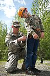 Army Staff Sgt. Christopher Sells inspects the harness of his son, Arron.jpg